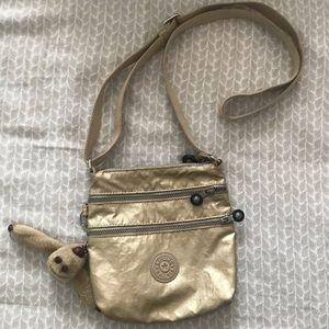 gold mini crossbody bag from kipling
